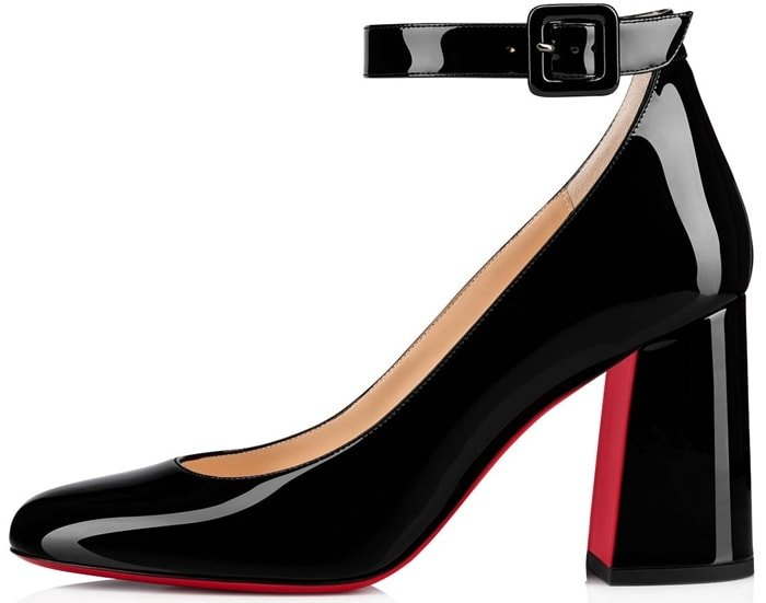 Christian Louboutin's Soval Mary Jane pumps are crafted in Italy of black patent leather