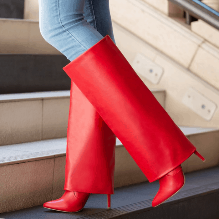 Red stiletto-heeled boot with a layered design and zipper closure