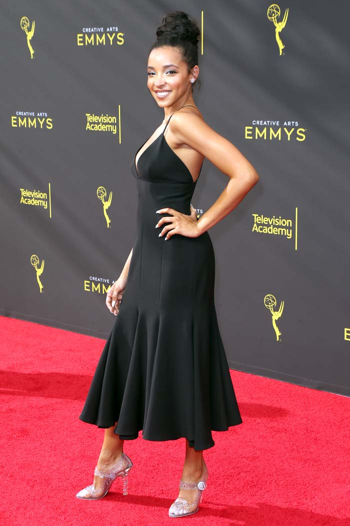 Tinashe in a black flared midi dress and Dolce & Gabbana Cinderella mary janes