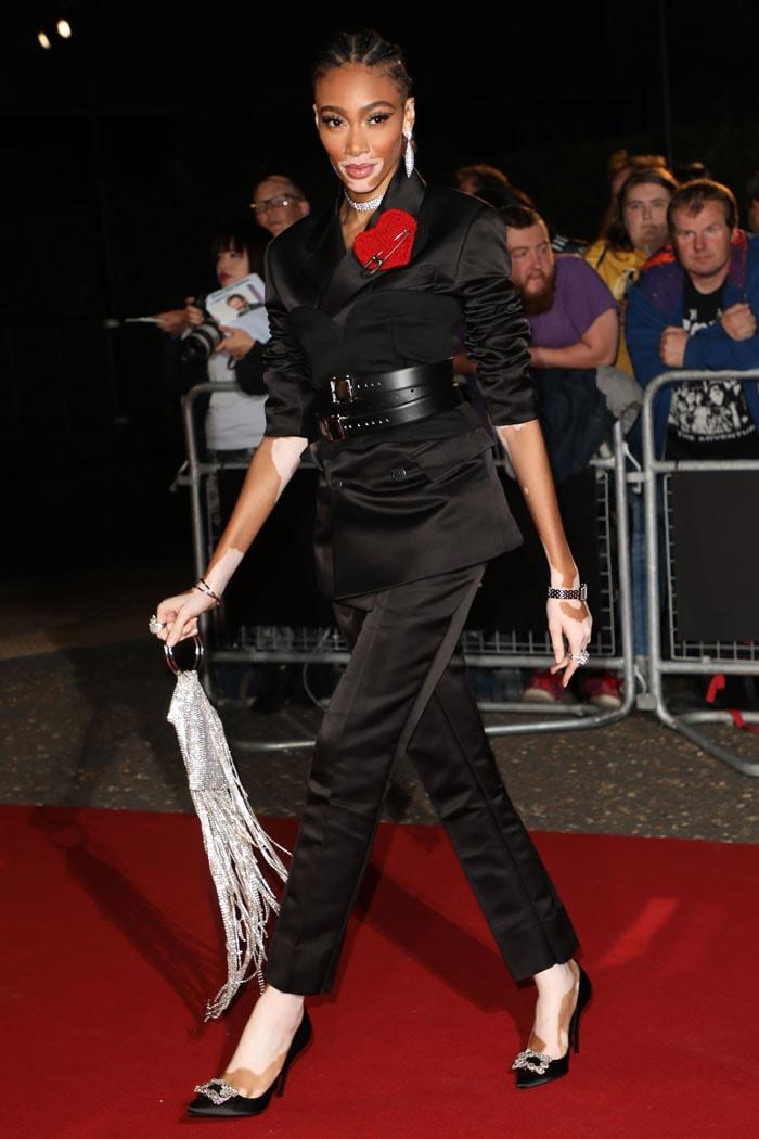 Winnie Harlow in a Prada fall 2019 menswear suit and Manolo Blahnik heels