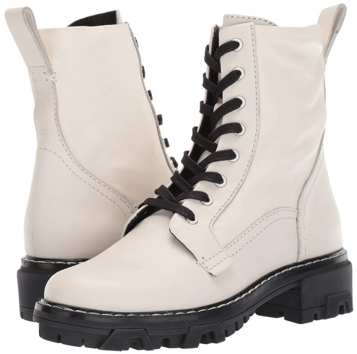 Side panels lend a bit of give to tough, combat-inspired merlot white boots set on a street-savvy lugged sole