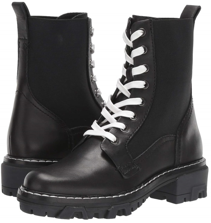 Side panels lend a bit of give to tough, combat-inspired black boots set on a street-savvy lugged sole