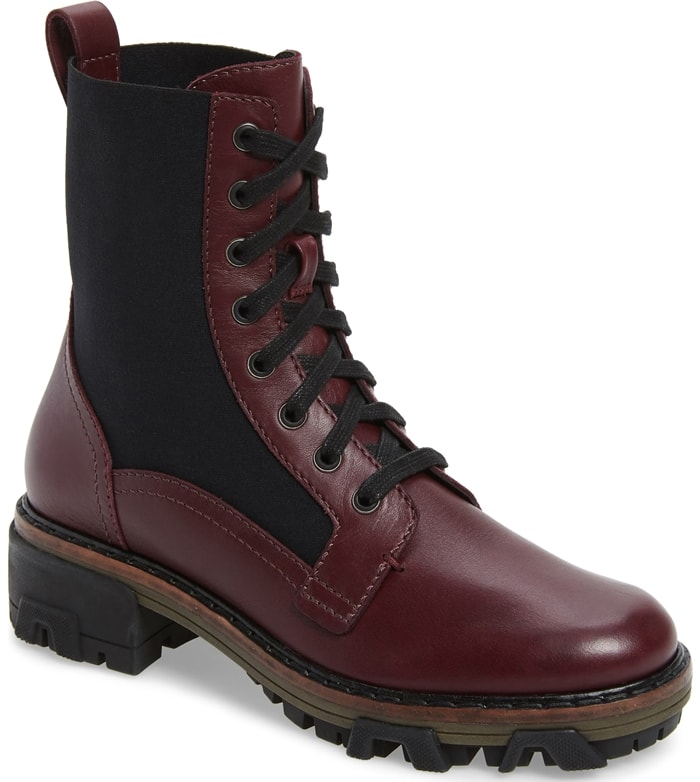 Side panels lend a bit of give to tough, combat-inspired merlot boots set on a street-savvy lugged sole