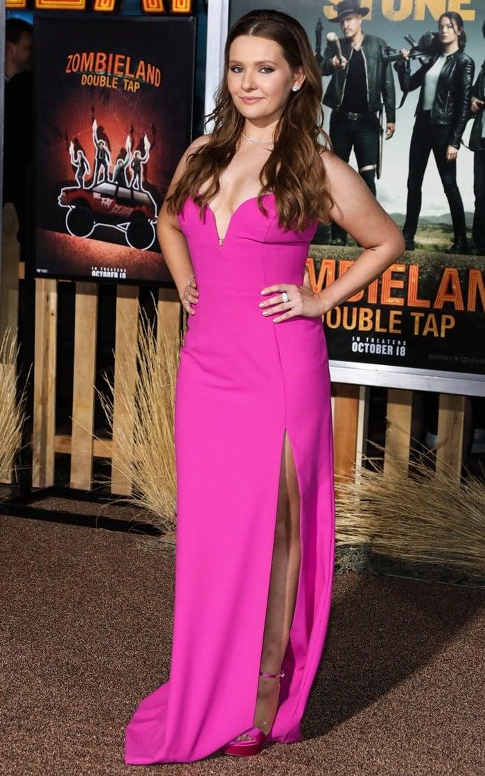 Abigail Breslin donned a hot pink plunge neck dress from Jill Jill Stuart