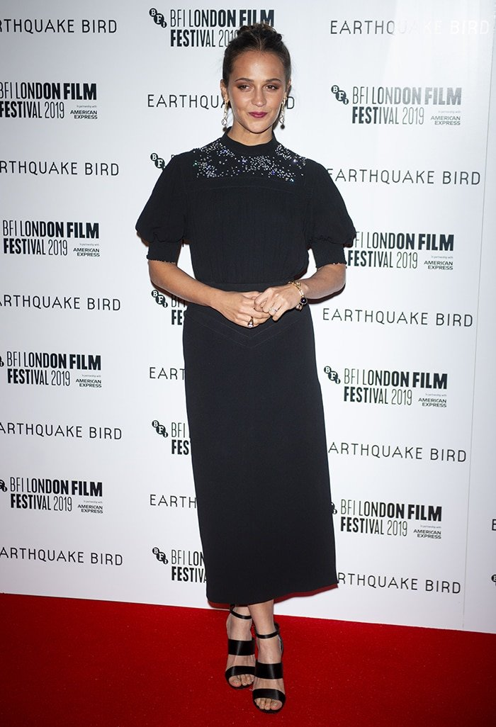 Alicia Vikander in a Louis Vuitton ensemble at the premiere of Earthquake Bird during theBFI London Film Festival at the Vue West End on October 10, 2019