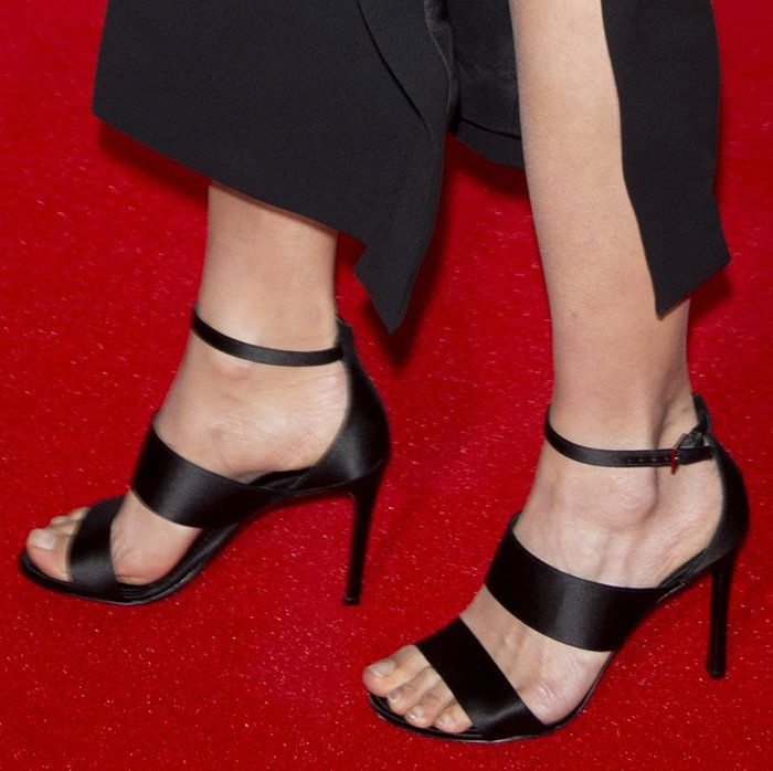 Alicia Vikander displays her toes in black Louis Vuitton shoes