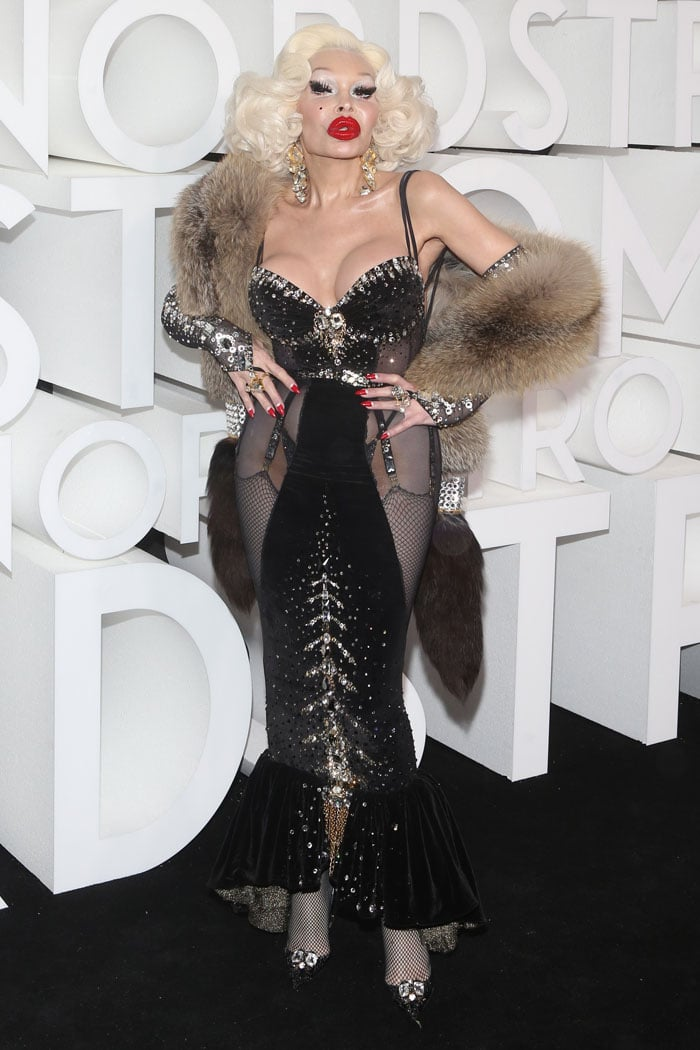 Amanda Lepore in a butt cleavage dress and bedazzled Louboutin pumps