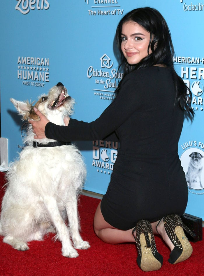 Ariel Winter petting Happy the dog at 9th Annual American Humane Hero Dog Awards