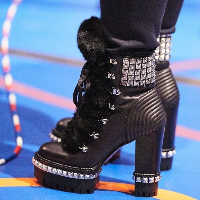 Evoke a tough-luxe vibe with these black Yeti Donna ankle boots from Christian Louboutin