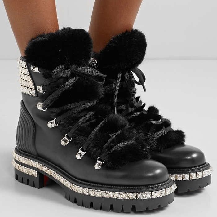 These black leather boots feature a faux-fur tongue for a fashion-forward spin on traditional snow footwear and are punctuated with silver-tone studs