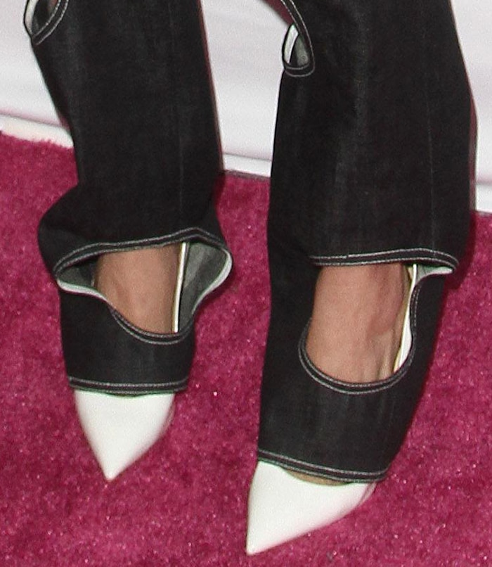 Cara Delevingne wears white pointy pumps