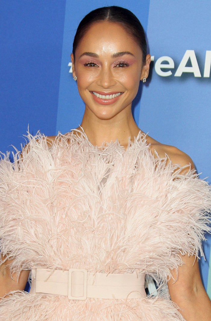 Cara Santana looks lovely in a Nicole + Felicia pink feathered dress