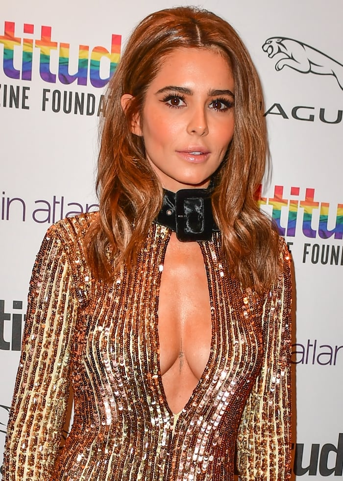 Cheryl Cole's mini dress has a buckled velvet collar that contrasts the plunging neckline