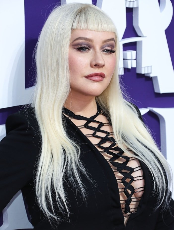 Christina Aguilera wore a revealing lace-up dress from Tom Ford
