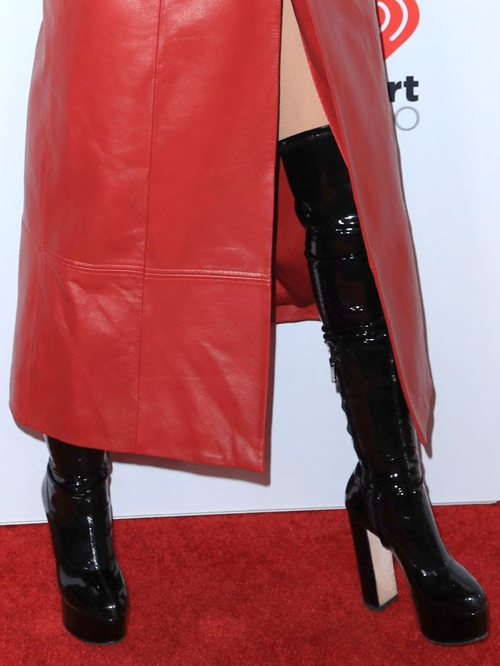 Christina Aguilera wearing black latex thigh-high boots
