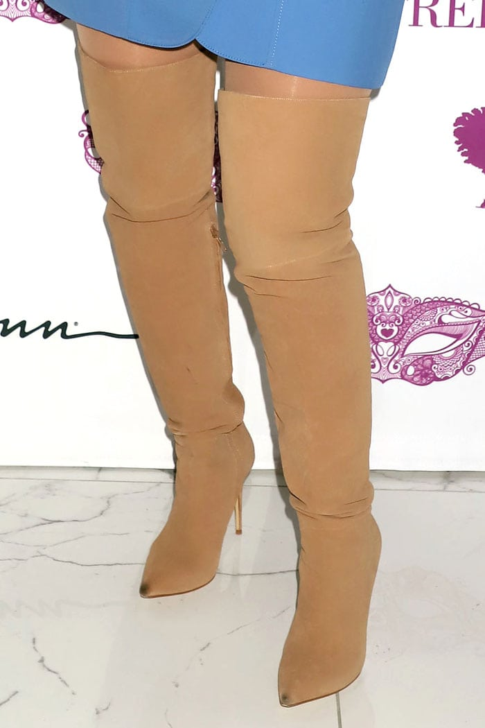 Christina Aguilera wearing flesh-tone boots with dirty pointy toes