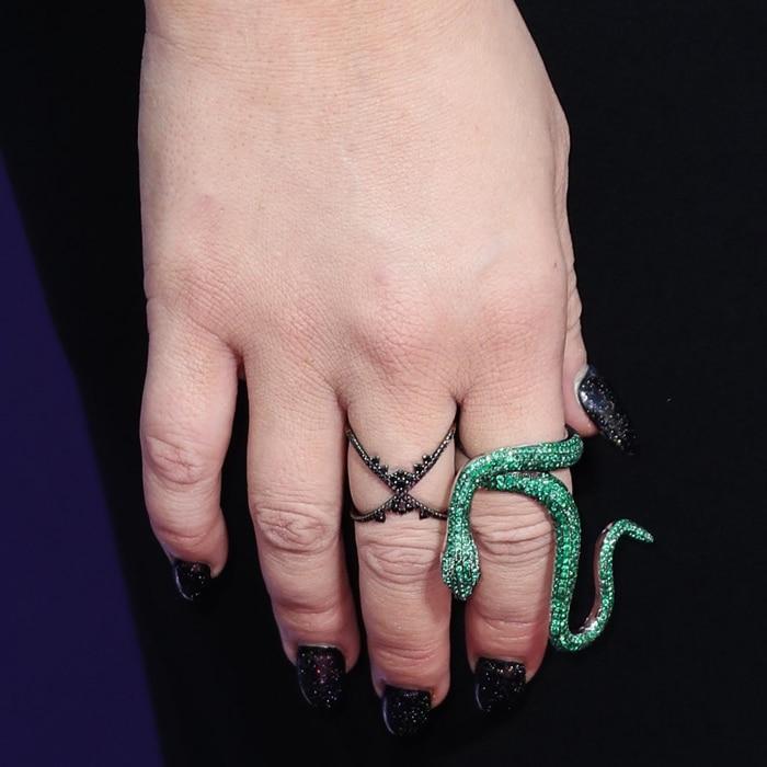Christina Aguilera's green snake ring and black nails