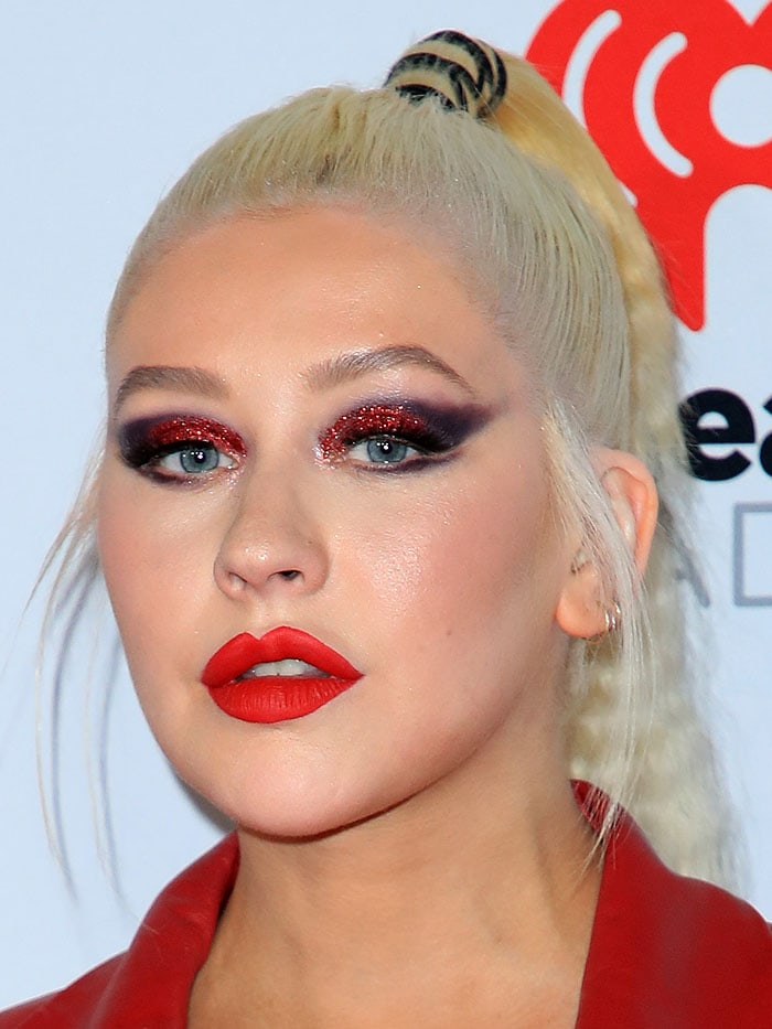 Christina Aguilera's glittery red eyeshadow and red lipstick