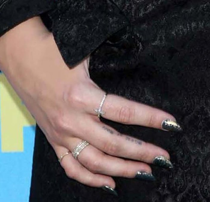 "Demi Lovato's ""Rock N Roll"" finger tattoo"
