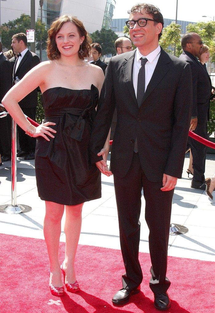 Actors Elisabeth Moss and Fred Armisen arrive at the 61st Primetime Emmy Awards