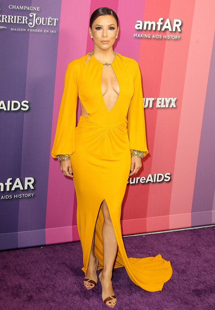 Eva Longoria wows in a mustard Dundas gown at the 10th Annual amfAR Los Angeles Gala held at Milk Studios in Los Angeles on October 10, 2019