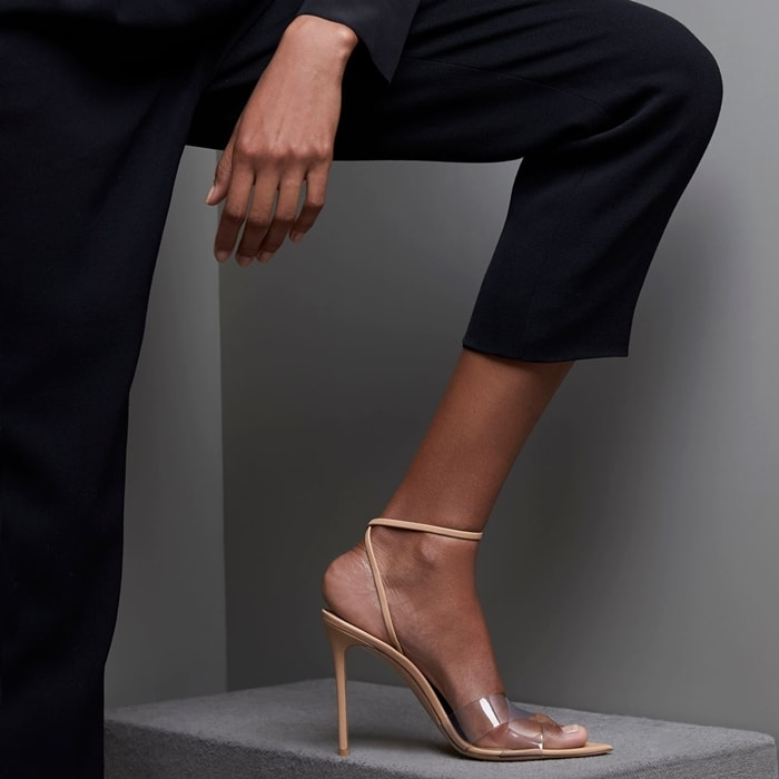 Expertly made in Italy, these Stark sandals have a pointed toe and clear PVC crossover straps to create the illusion of longer legs