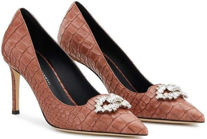 These high-heel, alligator print pumps are characterized by their vintage pink colour, and embellished by a crystal accessory on the front