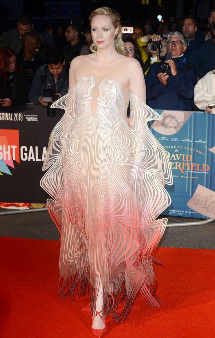 Gwendoline Christie slaying the red carpet in an Iris van Herpen Haute Couture dress and Christian Louboutin Alminetta red suede pumps