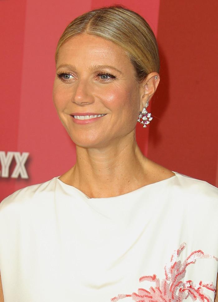 Gwyneth Paltrow looks classy in Adam Lippe long white dress and Bulgari jewels
