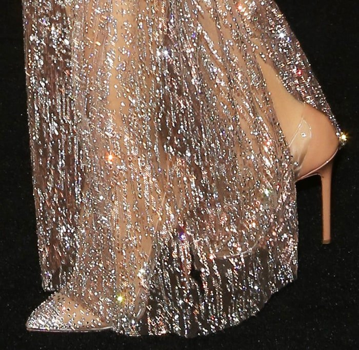 Hailee Steinfeld slips into a pair of Christian Louboutin crystal-embellished pumps