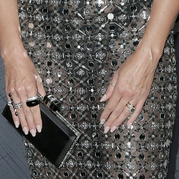 Heidi Klum's Rami Kadi mirrored-and-beaded mesh dress, Judith Lieber black-satin clutch, Lorraine Schwartz jewelry, and green gemstone engagement ring