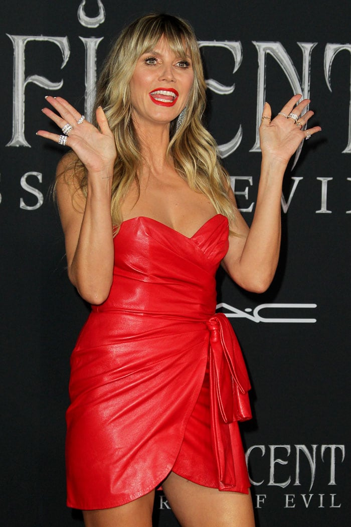 Heidi Klum wearing a Dundas red strapless leather dress