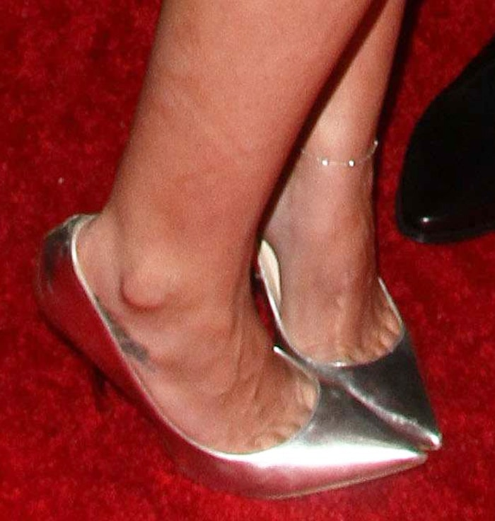 Hilary Duff completes her look with mirror metallic pumps by Jimmy Choo
