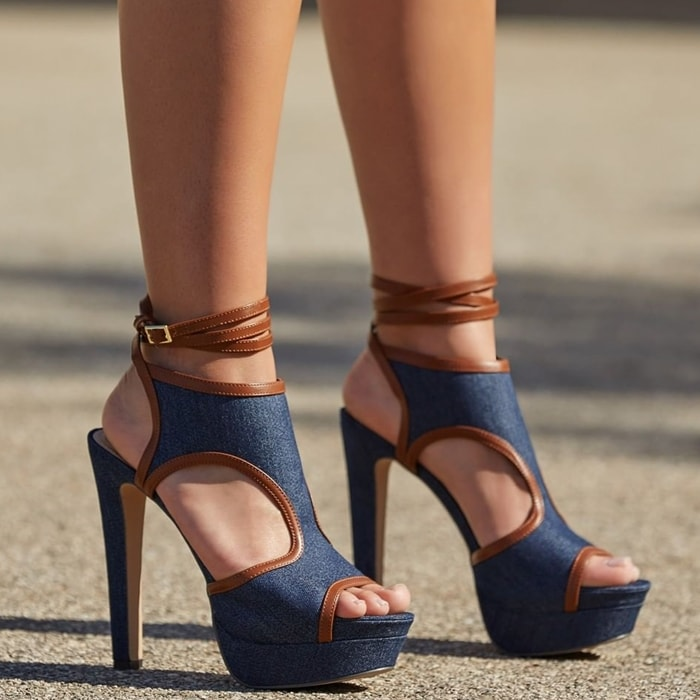 This platform sandal features a high stiletto heel, side cutouts, and wraparound ankle strap with buckle closure