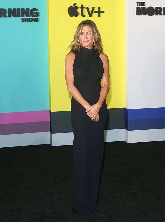 Jennifer Aniston shows her figure in a classy James Galanos black dress