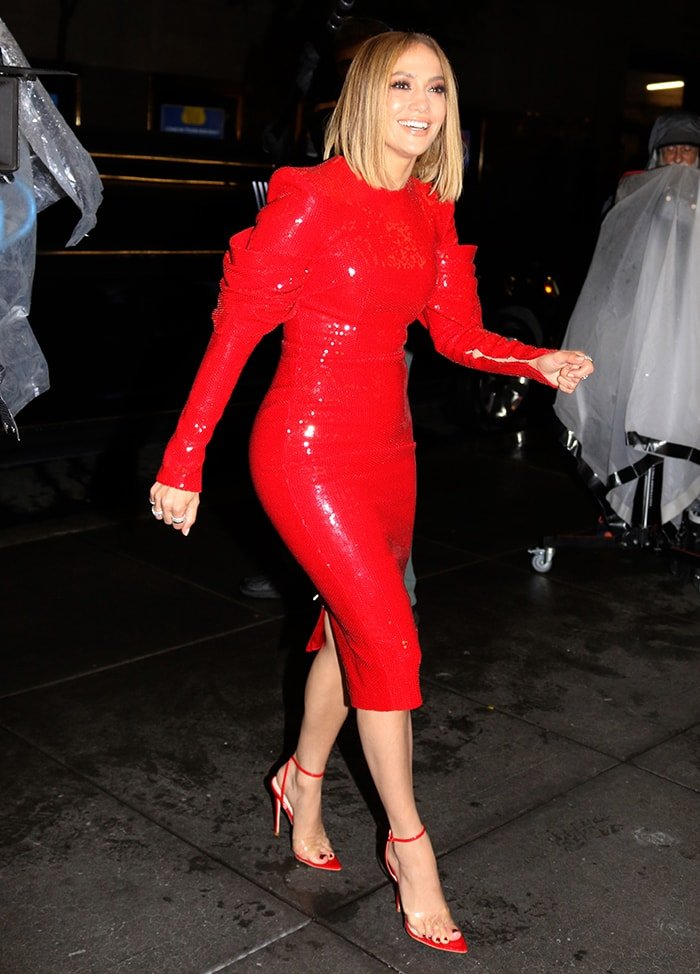 Jennifer Lopez looks glamorous in a red Alex Perry sequined midi dress