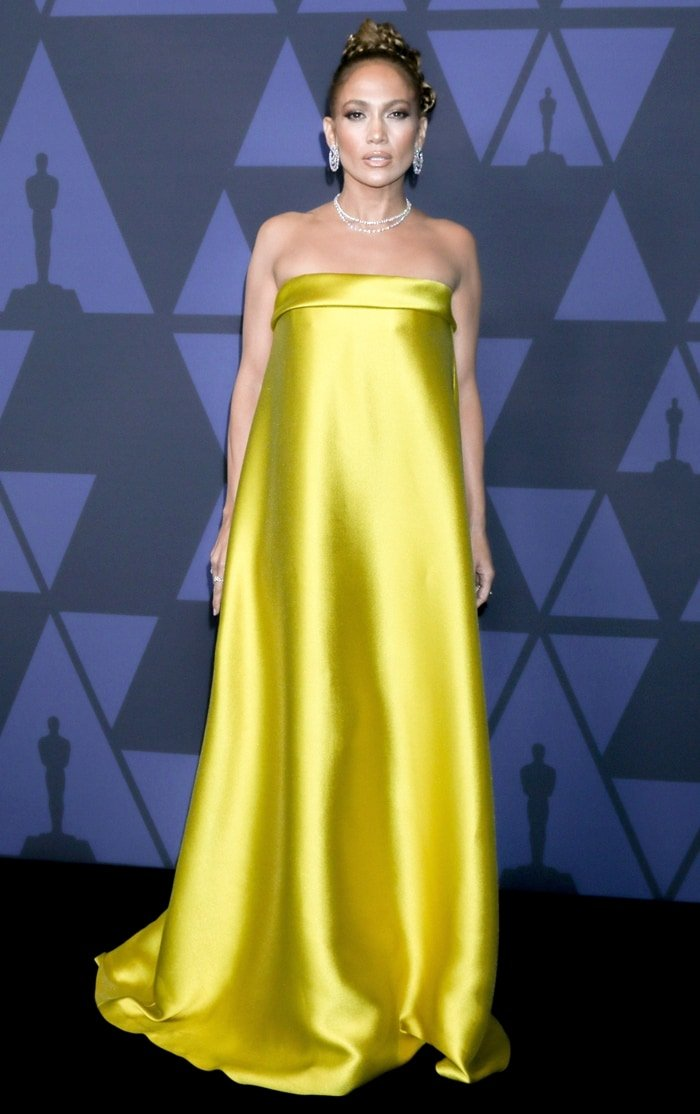 Jennifer Lopez in a strapless yellow gown on the black carpet as she arrives at the 2019 Governors Awards