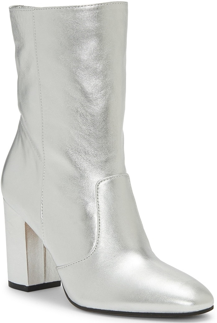 Clean, minimalist lines add modern attitude to an essential bootie set on a classic block heel