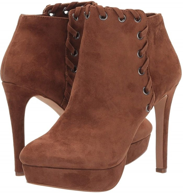Whipstitched trim and a platform sole add suave vintage vibes to this lofty Reecie bootie
