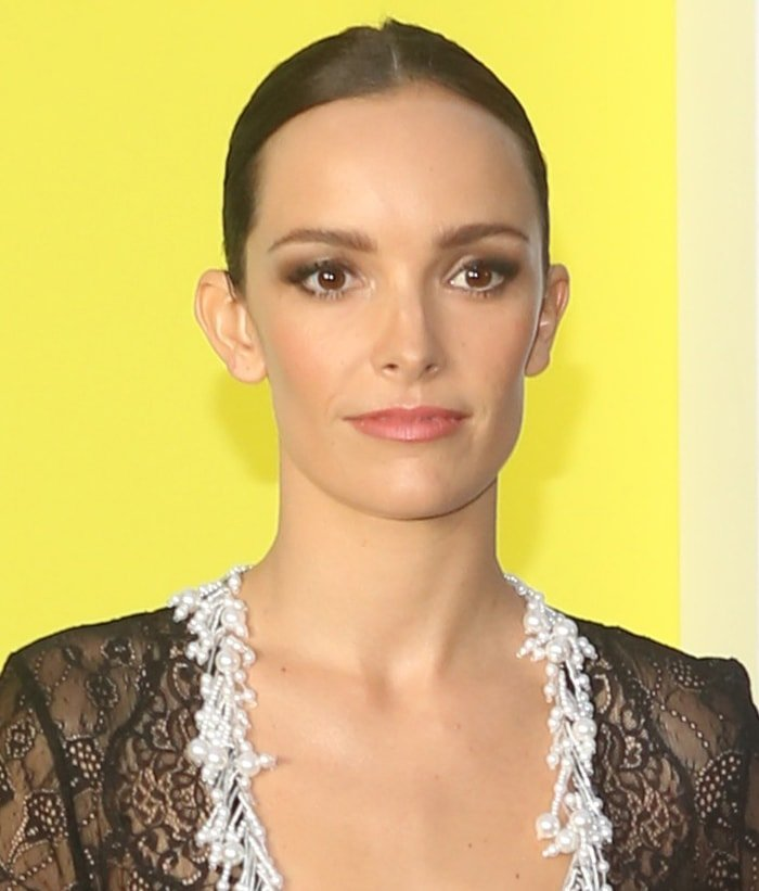 Jodi Balfour wears center-parted bun and pink lipstick