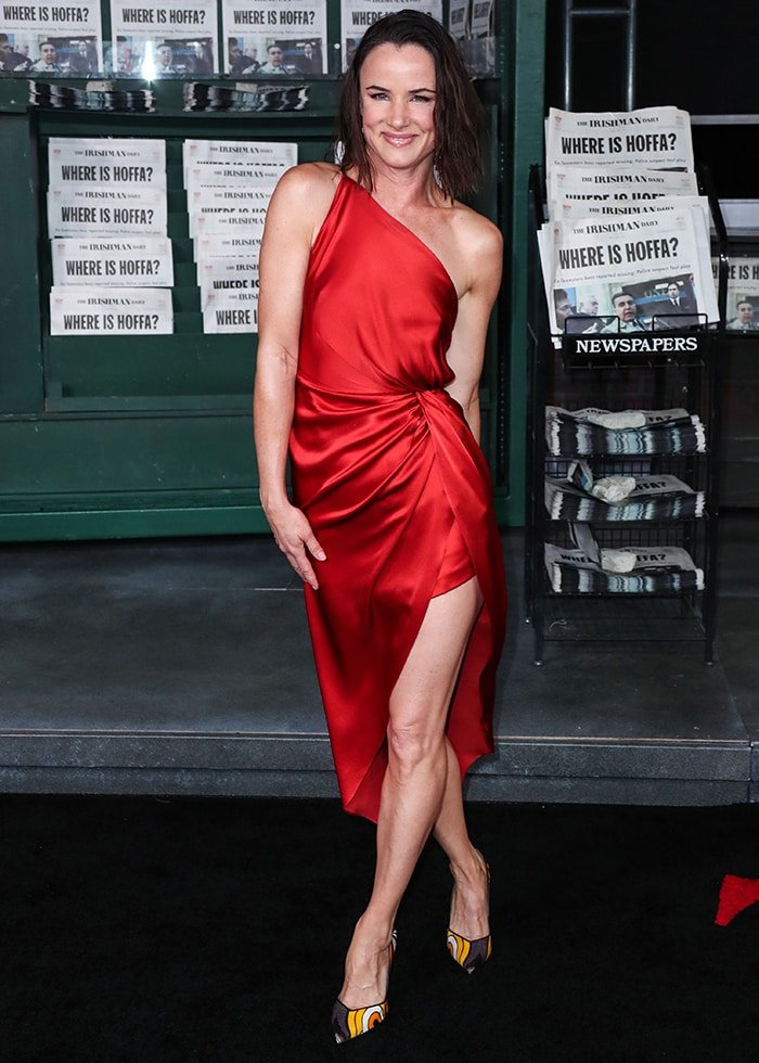 Juliette Lewis looks sultry in a silky red Michelle Mason dress