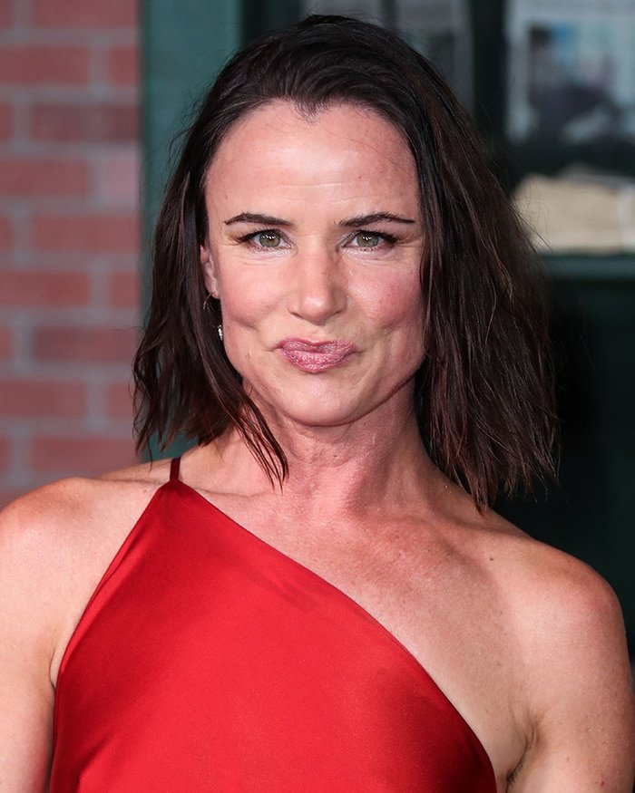 Juliette Lewis sports a messy bob and wears shimmery eye-makeup and pink lipstick
