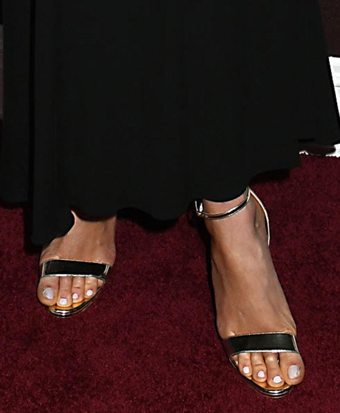 Karlie Kloss displays her painted toenails in Christian Louboutin sandals