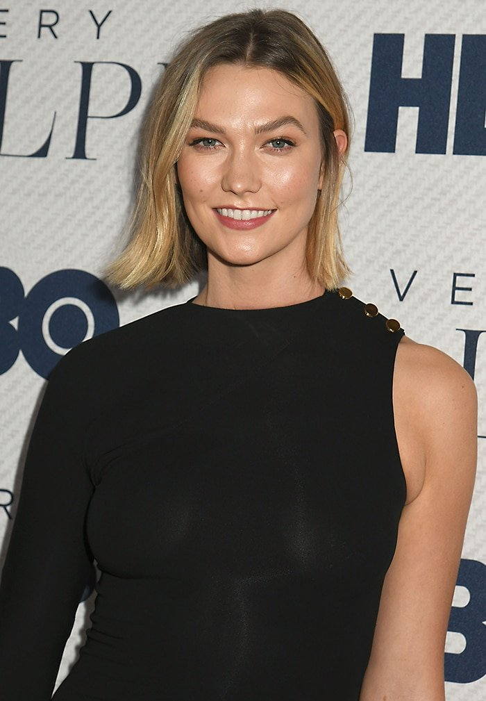 Karlie Kloss keeps a simple look with a short bob and soft makeup