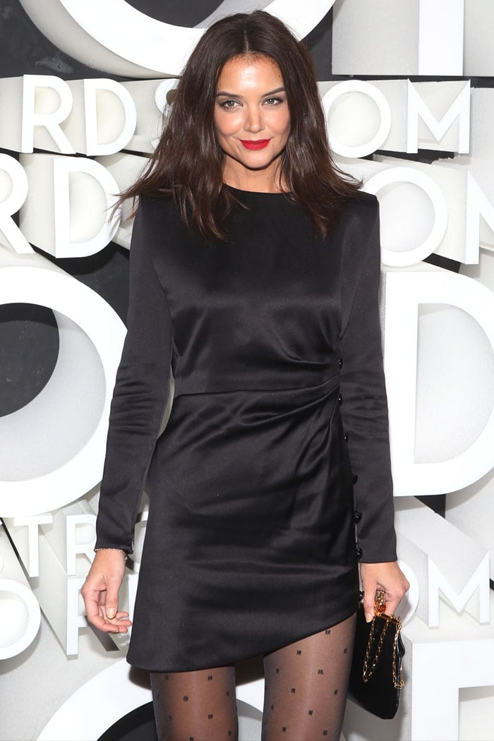 Katie Holmes in a Saint Laurent Fall 2019 black satin dress