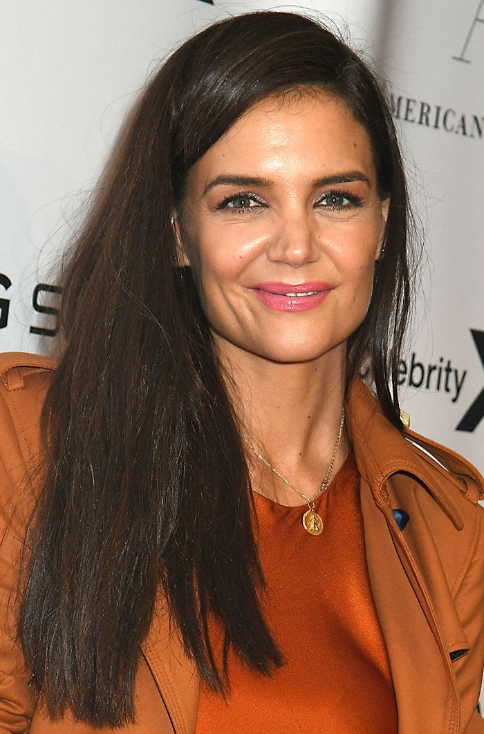 Katie Holmes wears her long brown hair down and sports pink lipstick