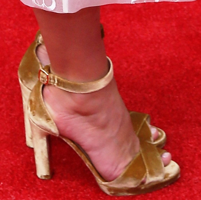 Keira Knightley shows off her feet in Rupert Sanderson gold velvet heels