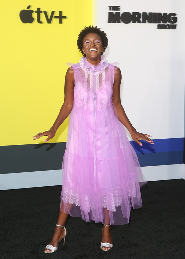 Krys Marshall flashes her legs in a purple tulle lace Marc Jacobs dress