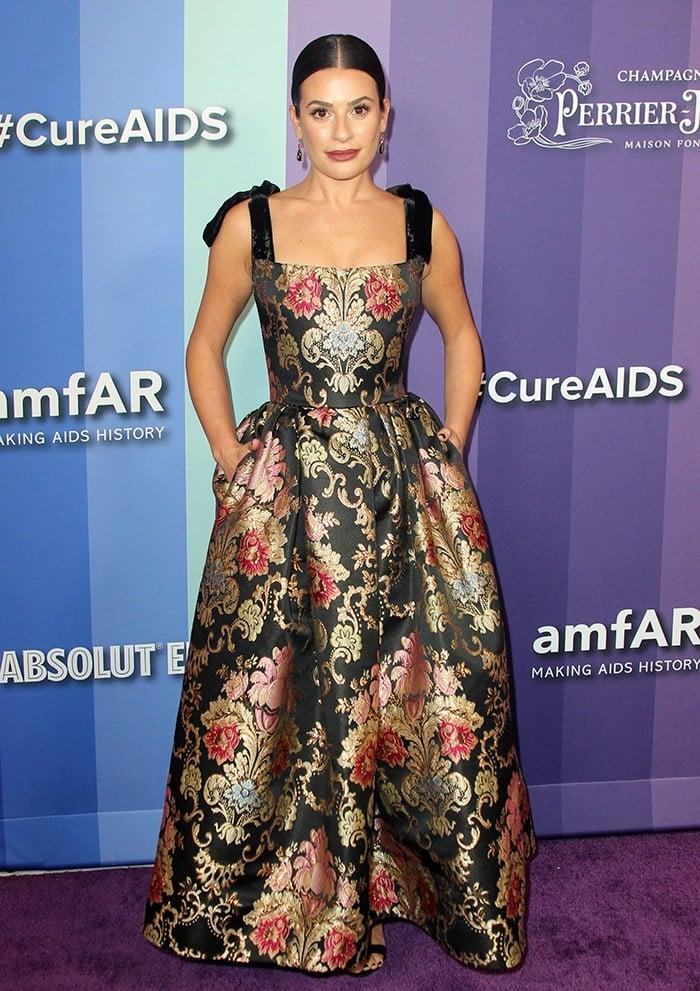 Lea Michele looks regal on the purple carpetat the 10th Annual amfAR Los Angeles Gala held at Milk Studios in Los Angeles on October 10, 2019