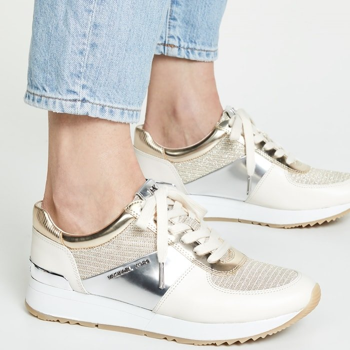 White and gold sneakers with jeans from Michael Kors